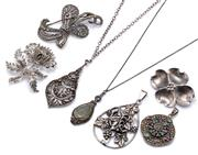 Sale 9083 - Lot 562 - A GROUP OF SILVER JEWELLERY;  marcasite set thistle and bow brooches, and two drop pendants on cable link chains incl. one set with...