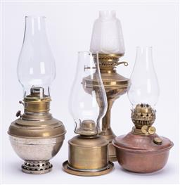 Sale 9185E - Lot 64 - A group of four brass bound kerosene lanterns including Millers and Waterbury, tallest Height 45cm