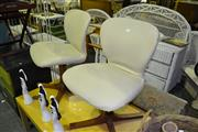 Sale 8013 - Lot 1096 - Pair of Cream Leather Upholstered Swivel Chairs