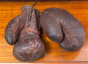 Sale 8261A - Lot 5 - A pair of vintage brown leather boxing gloves