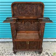 Sale 8649R - Lot 176 - Impressively Carved Oriental Hardwood Drinks Cabinet with Lift Top and Drop Front (H: 110 W: 84 D: 44cm)