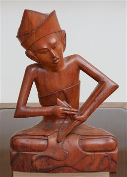 Sale 9097H - Lot 72 - A carved seated figure of a musician, Height 28cm a present from Nancy Bird Walton to Khamal AM