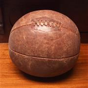 Sale 8261A - Lot 6 - An old leather medicine ball with leather lacing