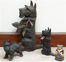 Sale 9103M - Lot 595 - A large Scottish terrier door stop height 39cm in cast iron together with a smaller example and two others.