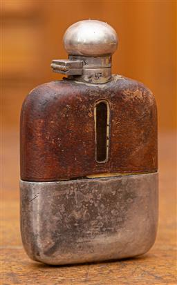 Sale 9160H - Lot 55 - A James Dixon & Sons plated and leather bound hip flask, Length 13cm