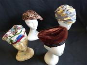 Sale 7982B - Lot 37 - Four bohemian-style fascinators, one of which is Christian Dior