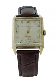 Sale 8406A - Lot 69 - A fine vintage Art Deco style Girard Perregaux tank shaped dress watch in gold filled case with raised glass, tan leather strap, 26...