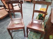 Sale 8444 - Lot 1021 - Pair of Chinese Carved Rosewood Side Chairs, in the European style, the rail backs with stylised flowers (frames loose)