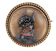 Sale 8965 - Lot 366 - AN ANTIQUE ESSEX CRYSTAL DOG BROOCH; 20mm round reverse intaglio paste hand painted chihuahua (flaking) set in 14ct with bead border...