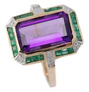 Sale 9046 - Lot 508 - A DECO STYLE AMETHYST AND GEMSET RING; centring an emerald cut amethyst surrounded by mixed cut emeralds and 8 round brilliant cut d...