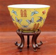 Sale 9055H - Lot 46 - A Qing dynasty famille verte bowl decorated with butterflies amidst double happiness symbols and character marks to base, with a tim...