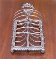 Sale 8346A - Lot 57 - A Regency Sheffield plate wire toast rack with elegant design on ball feet