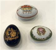 Sale 8436A - Lot 73 - A group of three Limoges pill boxes of egg form.