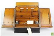 Sale 8500 - Lot 1037 - Victorian Dark Stained Oak Desk Compendium, with fitted interior incl. perpetual calendar & glass inkwells, with concealed drawer to...