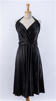 Sale 8891F - Lot 70 - A Colette Dinnigan black pure silk satin halterneck cocktail dress with fluted hem, size medium
