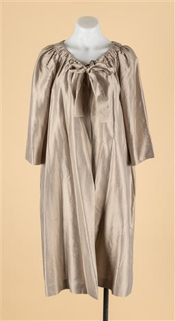 Sale 9260H - Lot 385 - A Max Mara overcoat in metallic beige, with tie to front & gathered neckline, size US 8.