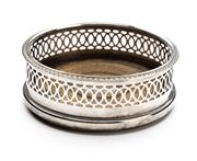 Sale 8517A - Lot 16 - An English silver plated wine coaster with pierced gallery, D 11.5cm