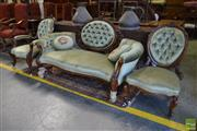 Sale 8520 - Lot 1036 - Victorian Carved Walnut Three Piece Salon Suite, the settee with cameo in pierced frame buttoned in green velvet, with conforming ge...