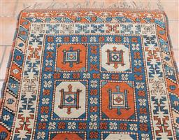 Sale 9120H - Lot 68 - An antique possibly Turkish carpet with alternating coloured medallions, 175cm x 119cm