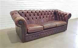 Sale 9142 - Lot 1023 - Brown Leather Chestfield 3-Seater Lounge, with buttoning also to front fascia (h:80 w:205 d:86cm)