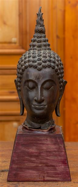Sale 9160H - Lot 56 - A Thai bronze buddha head with flaming finial, on removable base, Height of head 45cm, base Height 16cm