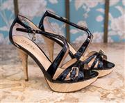 Sale 8474A - Lot 48 - A gorgeous pair of Guess black patent strappy heels, featuring raffia platform & heel design, small G logo charm on buckle, as new,...