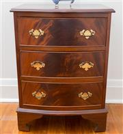 Sale 8530A - Lot 90 - A vintage English flame mahogany 3 drawer bow front chest with brass drop handles to the cocked bead drawers raised on 4 bracket fee...
