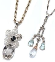Sale 9046 - Lot 579 - TWO SILVER GEMSET PENDANT NECKLACES; a 45cm long rope twist chain attached with a cannetille flower set with an oval cut blue sapphi...