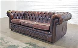 Sale 9142 - Lot 1018 - Brown Leather Three-Seater Chesterfield Lounge, with buttoning including to front rail - damaged (h:72 w:207 d:90cm)
