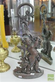 Sale 8217 - Lot 80 - Cast Metal Cherubic Door Stop