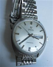 Sale 8362A - Lot 89 - A vintage Omega Seamaster day date automatic mens watch, case diameter 35 mm, original Omega bracelet