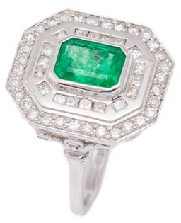Sale 9221 - Lot 388 - AN 18CT WHITE GOLD EMERALD AND DIAMOND RING; deco style octagonal mount centring an emerald cut emerald of approx. 1.40ct within a d...