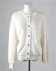 Sale 8541A - Lot 61 - A Celine white knit cardigan with lapels and gilt monogrammed buttons, pockets, size M-L