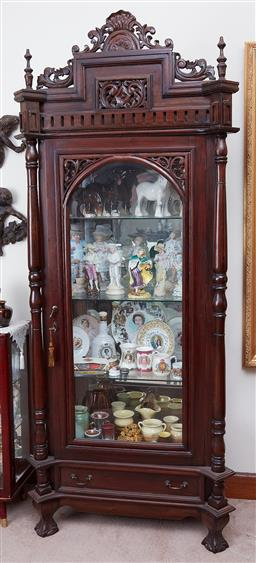 Sale 9103M - Lot 428 - A mirror back timber and glass display cabinet with leaf scroll decorations including four glass shelves and drawer. Height 220cm x...