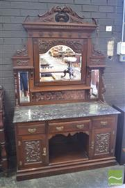 Sale 8255 - Lot 1097 - Late Victorian Carved Walnut Washstand, with adjustable mirror & tiled back, black marble top, three drawers & two doors flanking an...