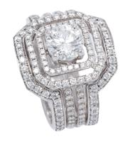 Sale 8965 - Lot 393 - AN 18CT WHITE GOLD DIAMOND RING SUITE; central ring features a round brilliant cut diamond of approx. 1.01ct, P1 on a double border...
