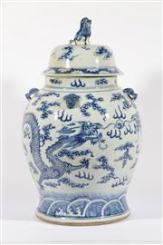 Sale 9003C - Lot 602 - Large Chinese Blue and White Lidded Vessel Decorated with Dragons, Flames and with a Temple Dog Finial (H: 64cm)