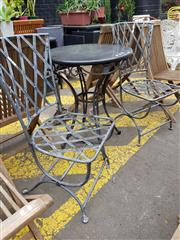 Sale 8740 - Lot 1237 - Metal Three Piece Outdoor Suite incl. Round Granite Top Table & Pair of Chairs