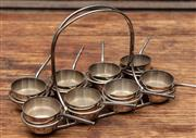 Sale 8942H - Lot 81 - A set of eight miniature silver-plate  saucepans in a carry case