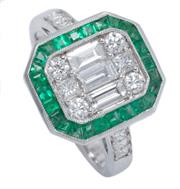 Sale 8965 - Lot 400 - A DECO STYLE EMERALD AND DIAMOND RING; centring a cluster of 3 baguette, 2 princess and 4 round brilliant cut diamonds to a surround...