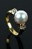Sale 3808 - Lot 458 - AN 18CT GOLD CULTURED PEARL AND DIAMOND RING;