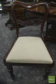 Sale 8335 - Lot 1003 - Set of Six Early 19th Century Mahogany Kidney Back Chairs, with cream diaper drop-in seats, on turned legs