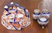 Sale 8346A - Lot 61 - A Ridways Old Derby pattern in the Imari style china egg cup carrier (4) with salt and pepper pots, D 26cm, together with a Continen...