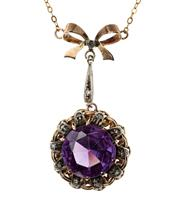 Sale 8426 - Lot 360 - A VINTAGE GEMSET PENDANT NECKLACE; 14ct basket mount centring a large synthetic purple sapphire surrounded by silver set diamond cry...