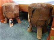 Sale 8550 - Lot 1418 - Pair of Brown Cow Hide Upholstered Stools on Rustic Timber Legs