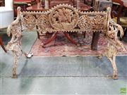 Sale 8598 - Lot 1082 - Victorian Cast Iron Two Seater Bench, with central hunting dog roundel and four smaller floral medallions (no seat)