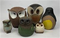 Sale 8725A - Lot 49 - A group of pottery owls and a penguin. (6)