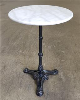 Sale 9218 - Lot 1033 - Waterproofed round marble top table on cast iron base (h:75 dia:50cm)