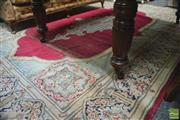 Sale 8291 - Lot 1027 - Vintage Persian Wool Carpet, with medallion on bright claret field & floral compartment border - some wear (335 x 237cm)