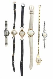 Sale 8315 - Lot 339 - SIX LADYS WRISTWATCHES; a 9ct gold Tudor with 17 jewell movement, cord band,  a stainless steel Omega with 17 jewell cal. 244 movem...